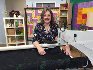 Angela Huffman, longarm quilter, quilting instructor, and APQS dealer