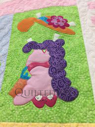 Dress Up Time Applique block designed by Amy Bradley, longarm machine quilting by Angela Huffman