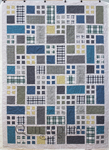 Linda made this lovely memorial quilt for a family member. She asked me to quilt this with a simple wide open meander to follow the simple piecing design.