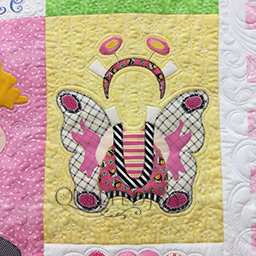 My Butterfly Costume applique pattern by Amy Bradley and machine quilting by Angela Huffman