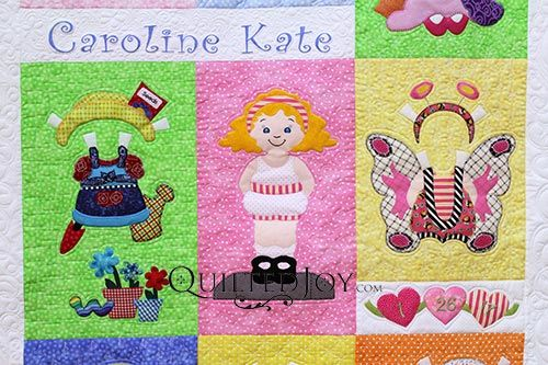 Paper Doll Quilt, pieced by Pam S. and longarm quilted by Angela Huffman