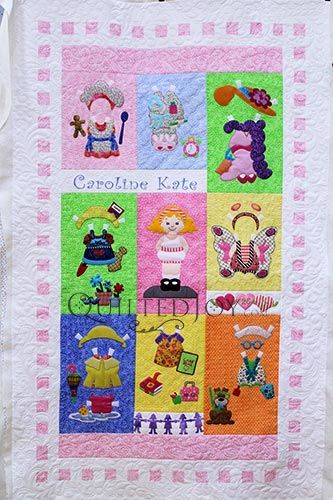 Paper Doll Quilt, designed by Amy Bradley, pieced by Pam S., and quilted by Angela Huffman