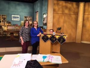 Angela Huffman and Sara Gallegos with the Line Drawings Mantle Scarf on Fons & Porter's Love of Quilting Show