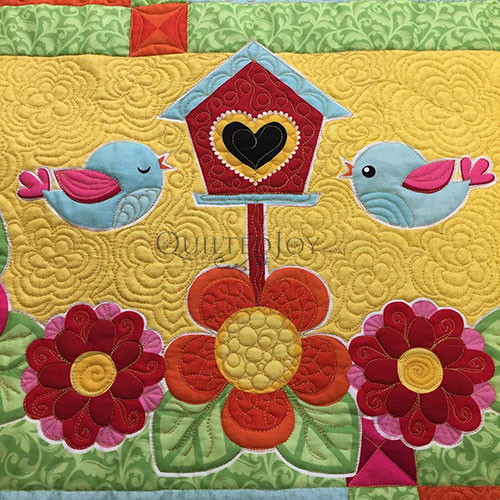 Learn to Machine Quilt a Baby Quilt in Angela Huffman's Class
