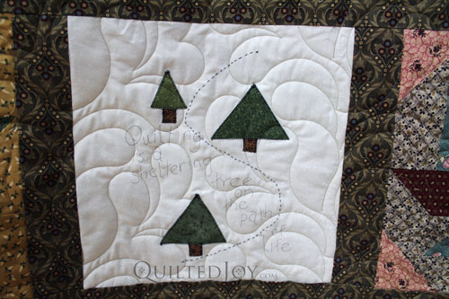 """Quilting is a Sheltering Tree on the Path of Life"" on Nancy's Patchwork Sampler Quilt"