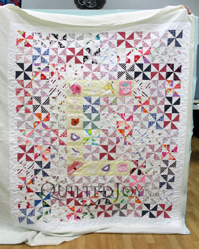Baby Quilt with the Letter C and Baby Clothes