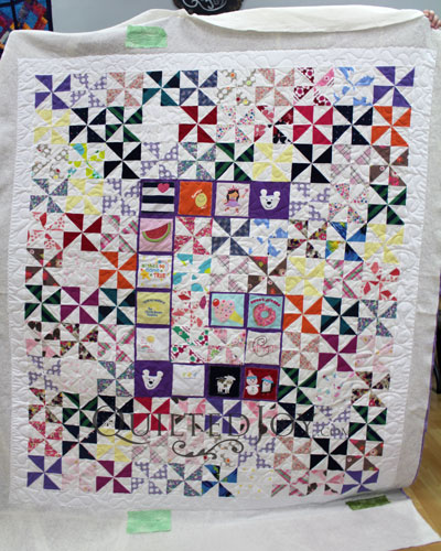 Baby Quilt with the Letter G and Baby Clothes