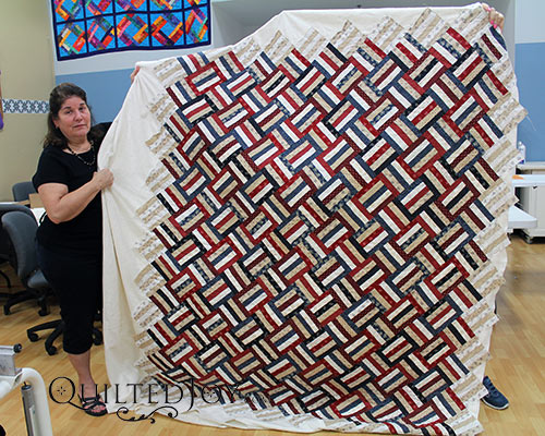 Quilting Buddies Jennifer and AnnaMaria show off their Patriotic Split Rail Quilt after renting a longarm at Quilted Joy