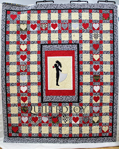 Signature Wedding Quilt with gold blocks signed by wedding guests and a beautiful center applique of a bride and groom