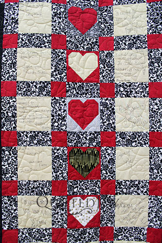 Wedding guests wrote notes and well wishes to the bride and groom on this signature wedding quilt