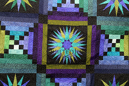 Jennifer rented the design boards and longarm quilting machine at Quilted Joy to quilt her Moon Glow quilt