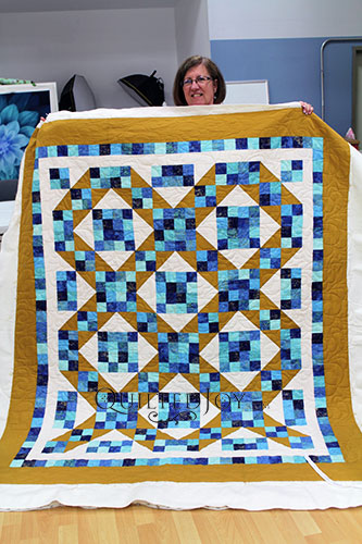 Judy quilted her Sunny Skies quilt at Quilted Joy
