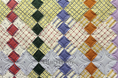 Continuous Curves Quilting in a Four Patch Block
