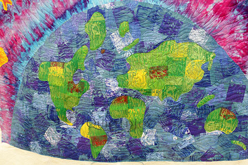 Hand Dyed Wholecloth Quilt depicting Earth, Free Motion Quilted with a Longarm Quilting Machine