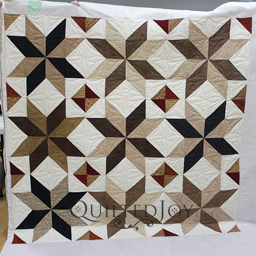 Continuous Curves or Line Dancing Quilting Design on a Big North Star Quilt