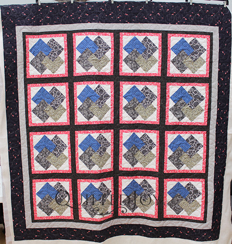 Barbara asked longarm quilter Angela Huffman to quilt her Card Trick Quilt