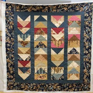 Danielle Made this Flying Geese Quilt with a Layer Cake