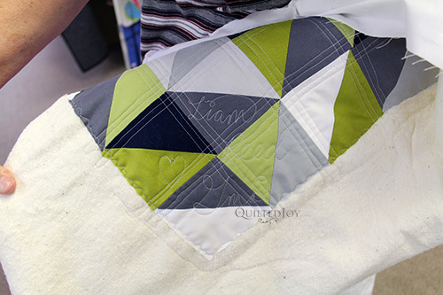 Gloria added a quilted signature to her quilt for her grandson