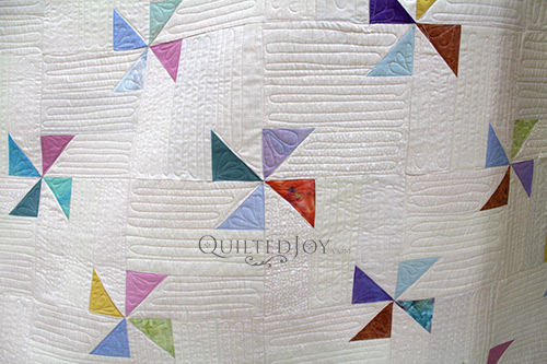 Starla's Pinwheel Quilt with free motion quilting and straight line quilting