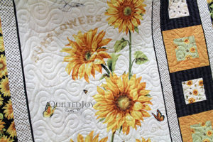 Donna's Sunflower Panel Quilt after renting a longarm quilting machine at Quilted Joy