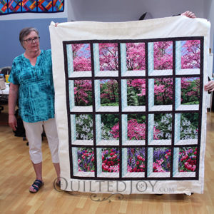 Layna's Attic Window Quilt after renting a longarm quilting machine at Quilted Joy