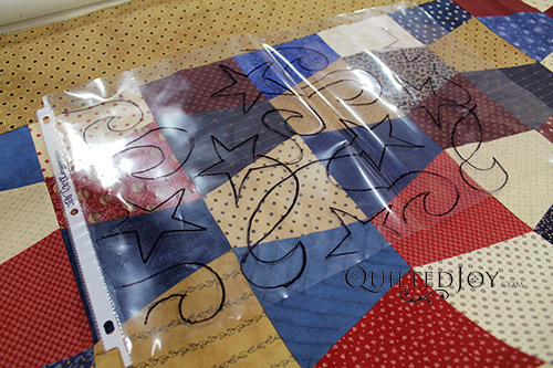 Use a sheet protector to create paper pantograph preview sheets that make it easy to audition paper pantographs on your quilt tops
