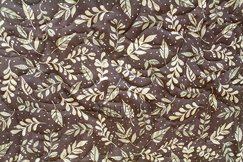 Cherri's brown leaf simple whole cloth quilt after a longarm machine rental at Quilted Joy
