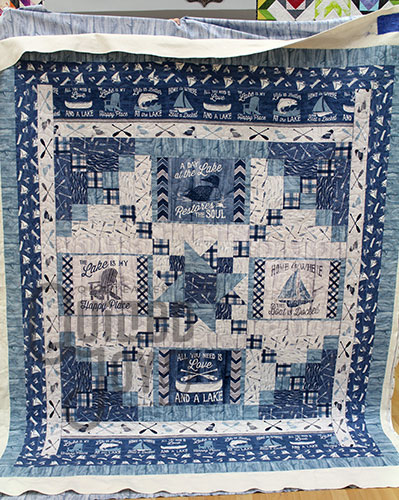Debra's lake house quilt after a longarm rental at Quilted Joy