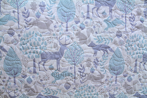 Judy's simple whole cloth quilt after longarm quilting at Quilted Joy