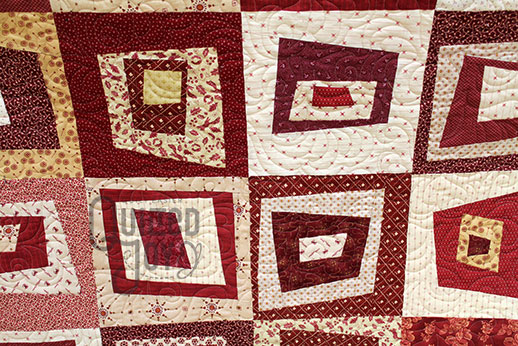 LuAnn's wonky squares quilt after renting a longarm machine at Quilted Joy