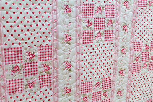 Nancy's pink and white roses quilt after longarm quilting at Quilted Joy