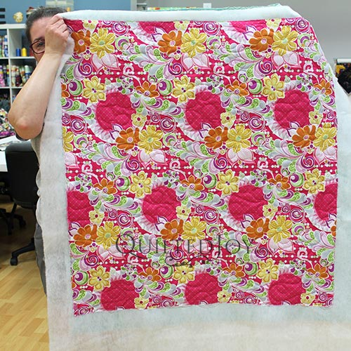 Free Motion Fantasy Fabric quilted with a longarm machine at Quilted Joy