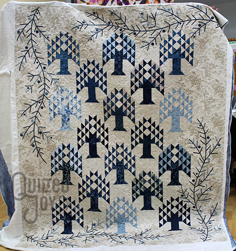 Anna Maria's winter quilt after longarm quilting it at Quilted Joy