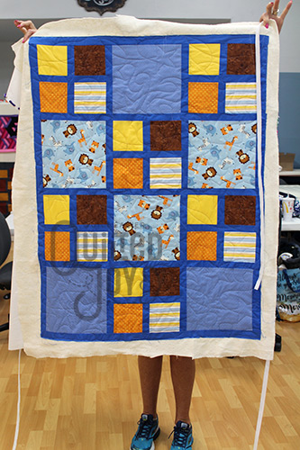 Baby Safari Quilt after longarm quilting at Quilted Joy