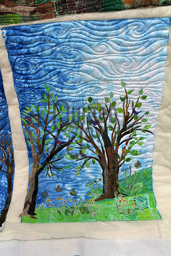 Hand dyed and stamped wall hanging quilt by Pat Sturtzel