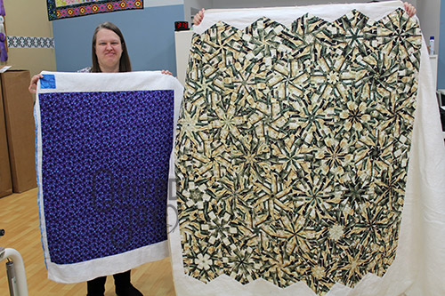 Amy and Linda show off their quilts after renting a longarm machine