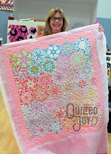 Cheri's One Block Wonder quilt after renting a longarm quilting machine at Quilted Joy