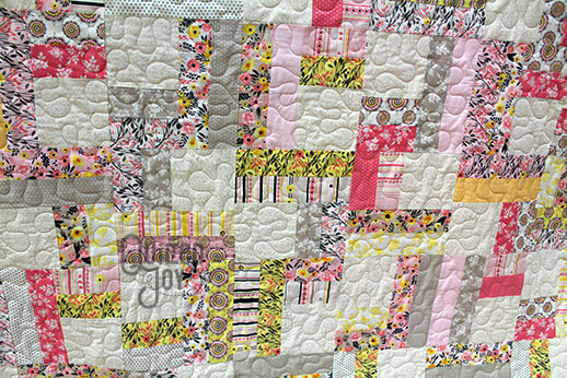 Kim's Split Rain Fence Quilt after renting a longarm quilting machine at Quilted Joy