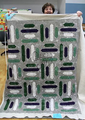 Pat quilted her Grunge Stripes Quilt on a longarm machine at Quilted Joy