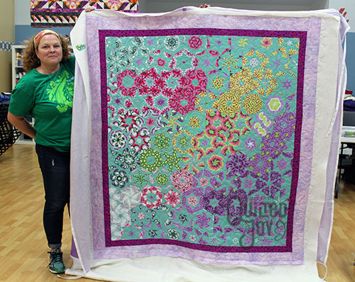 Rhonda's One Block Wonder quilt after renting a longarm machine at Quilted Joy