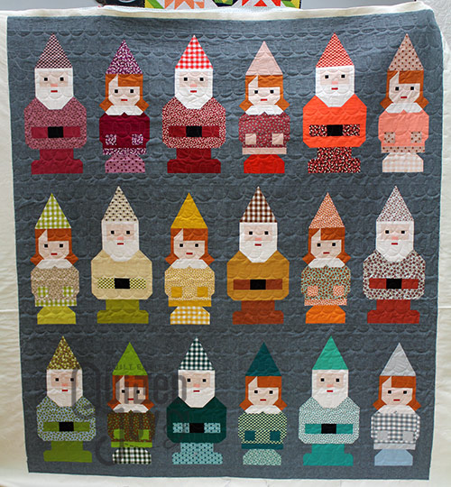 Erin's Garden Gnomes quilt after quilting it on a longarm machine at Quilted Joy