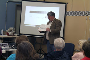 Kevin Laundroche gives a presentation on value at the Kentuckiana Longarm guild meeting at Quilted Joy