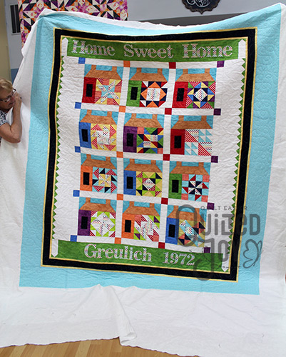 Jennifer's Home Sweet Home Quilt after quilting it at Quilted Joy