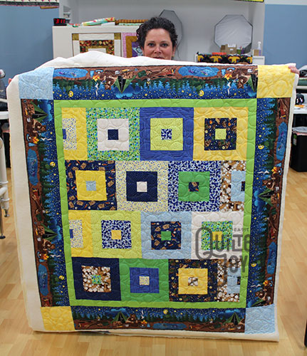 Kristie quilted this Campfire Quilt on a longarm machine at Quilted Joy