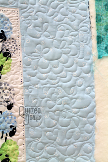 Anu's Suzybee Panel Quilt after quilting it on an APQS longarm quilting machine at Quilted Joy