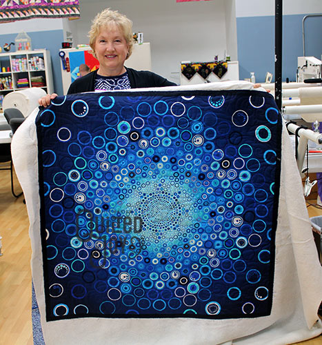 Kathy's Effervescence Panel Quilt after quilting it on an APQS longarm quilting machine at Quilted Joy