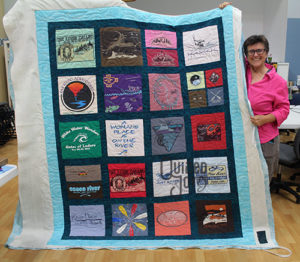 Pamela rented a longarm quilting machine to quilt this Rafting themed Tshirt Quilt