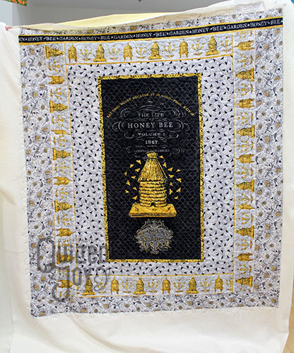 Peggy's A Bee's Life Panel after quilting it on an APQS longarm quilting machine at Quilted Joy