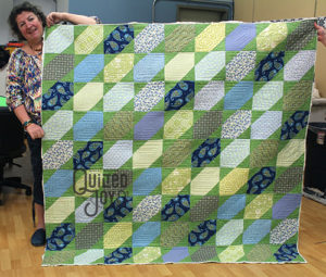 Starla's Slanted Star Quilt, quilted on a longarm quilting machine at Quilted Joy