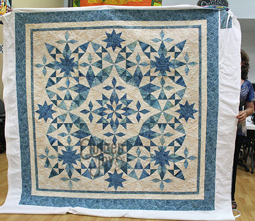 Anna Maria shows off her Alaska quilt after renting a longarm machine at Quilted Joy